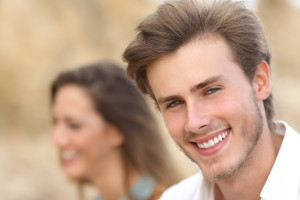 Handsome man portrait with a perfect white tooth and smile
